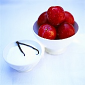 Plums and sugar with vanilla pod