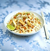 Rice noodle salad with shrimps and strips of omelette