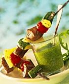 Lamb kebabs with rocket pesto