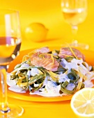 Ribbon pasta with salmon and cream sauce