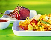 Lamb cutlets with egg noodles and white cabbage