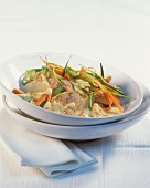 Turkey fillet on bed of vegetables with curried cream