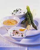 Cooked asparagus with three sauces