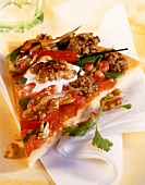 Piece of pizza with mince and pomegranate