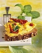 Wholemeal bread with scrambled egg and dried tomatoes