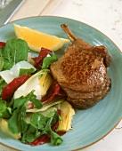Lamb cutlet with artichoke salad