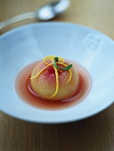 Poached peach in syrup