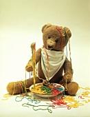 Teddy bear with coloured spaghetti