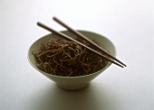 Asian noodles in bowl with chopsticks