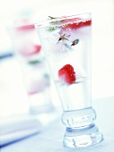 Glass of mineral water with strawberry