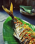 Barbecued fish on banana leaf