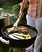Woman barbecuing in garden