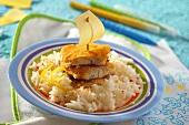 Breaded hake fillets on rice for children