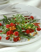 Rocket salad with raspberry dressing and walnuts