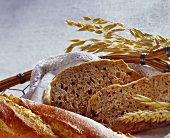 Baguette and wholemeal bread in bread basket