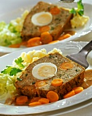 Meatloaf (Falscher Hase) with egg, carrots and mashed potato