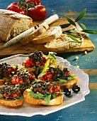 Crostini with tomatoes and olive paste