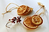 Dried orange slices on raffia; dried rose hips