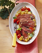 Beef steak with potatoes and cherry tomatoes