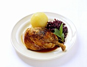 Duck leg with potato dumpling and red cabbage