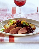 Duck breast with onion confit and fried potatoes