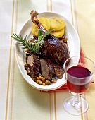 Goose braised in red wine with polenta slices
