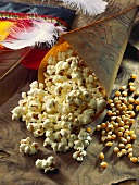 Popcorn in paper bag and Carnival decorations