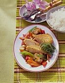 Turkey breast with sesame crust and Asian vegetables; rice