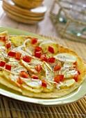 Pane Carasau condito (Flatbread with potatoes & onions)