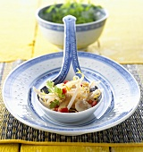 Soya sprout salad on spoon (China)