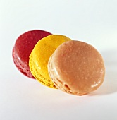Three macaroons with coloured icing