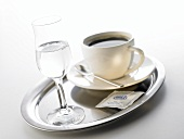 Grappa and coffee cup on tray