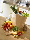 Shopping bag full of groceries in kitchen
