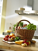 Shopping basket full of groceries on kitchen table