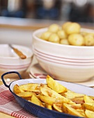 Oven-baked potatoes in a pan