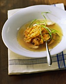 Chicken broth with deep-fried corn cakes