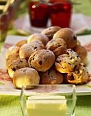 A heap of milk rolls with raisins; butter