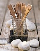 Wooden cutlery in glass for picnic