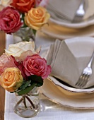 Small bouquets of roses on laid table