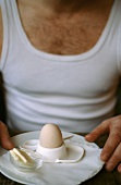 Man in vest with breakfast egg