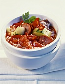 Pepper and tomato stew with sausage and rice