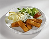Fish fingers with mashed potato and chive sauce