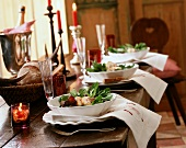 Rustic table with salads, champagne and candles