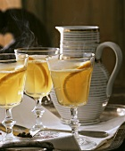 White mulled wine with orange slices