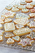 Iced Christmas biscuits on cake rack