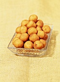 Marzipan potatoes in glass dish