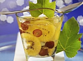Kiwi fruit and champagne jelly with black grapes