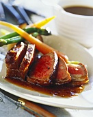 Roast beef with honey sauce and young vegetables