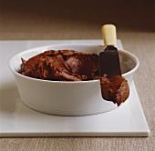 Chocolate hazelnut cream in bowl with knife
