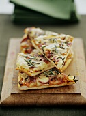 Pieces of pizza with potatoes, onions, cheese and rosemary